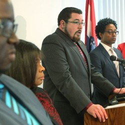 Ferguson Mayor James Knowles talks at a press conference Wednesday about revisions to the city's agreement with the U.S. Department of Justice to improve the way police and courts treat poor people and minorities. The Justice Department sued the city Wednesday over the revisions.