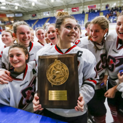 Scarborough captain Madison O'Reily holds the championship plaque after the Red Storm beat Falmouth 5-2 in the girls' hockey South regional final Wednesday at the Androscoggin Bank Colisee in Lewiston.
