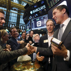 Jack Dorsey (L), CEO of Square and CEO of Twitter, is congratulated by Jim McKelvey, co-founder of Square, (2nd R) and NYSE President Tom Farley (R) after the IPO of Square Inc., in New York November 19, 2015. Square Inc priced shares at $9 for its initial public offering, about 25 percent less than it had hoped, as it struggled to win over investors skeptical about its business and valuation before trading begins on Thursday.  REUTERS/Lucas Jackson - RTS7Z1V