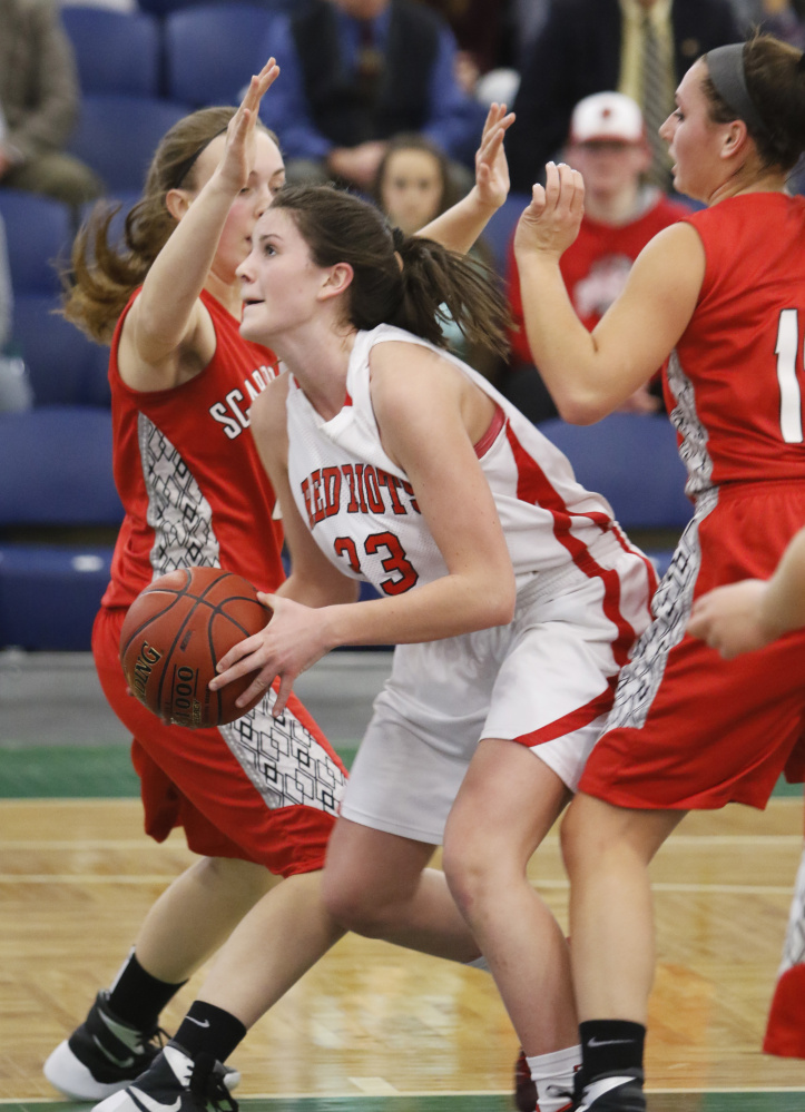 South Portland's Madeline Hasson finds an opening in Scarborough's defense during a Class AA South girls' basketball quarterfinal Wednesday night at the Portland Expo. Hasson scored 14 points in a 49-41 victory.