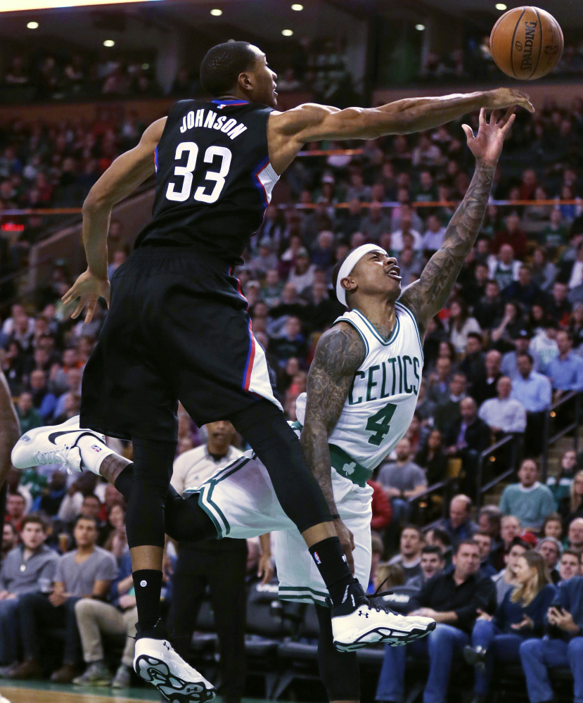 Clippers forward Wesley Johnson blocks a shot by the Celtics' Isaiah Thomas in the first quarter of Wednesday night's game. Thomas led the Celtics to an overtime win, scoring 36 points including a game-tying basket in the final seconds of the fourth quarter.