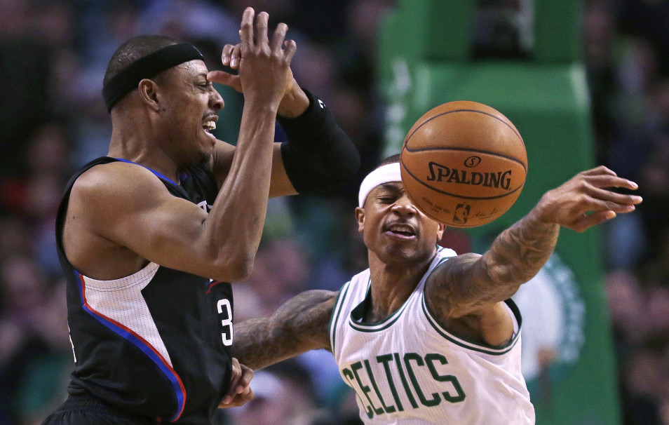 Celtics guard Isaiah Thomas knocks away a pass to Clippers forward Paul Pierce in the first quarter of what turned out to be a long, high-scoring win for the Celtics.