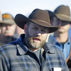four lines please Ammon Bundy speaks with reporter at a news conference at Malheur National Wildlife Refuge Friday, Jan. 8, 2016, near Burns, Ore. Bundy, the leader of an armed group occupying the national wildlife refuge to protest federal land management policies said Friday he and his followers are not ready to leave even though the sheriff and many locals say the group has overstayed their welcome. (AP Photo/Rick Bowmer)