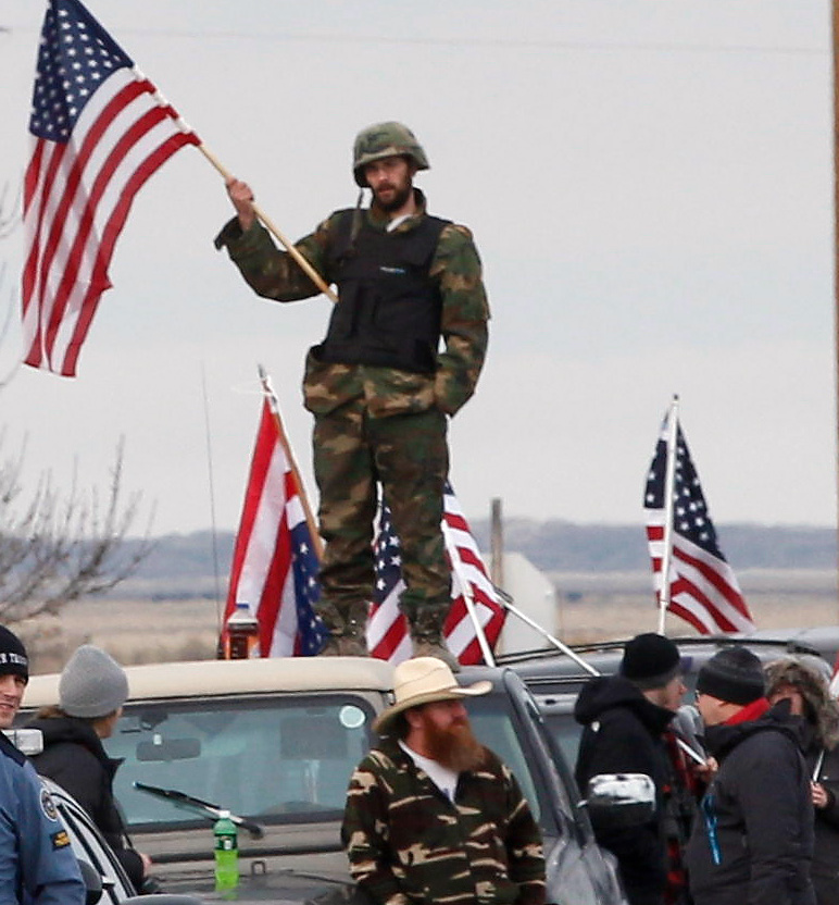 Authorities and demonstrators wait at the Narrows roadblock near the Malheur National Wildlife Refuge, Thursday, Feb. 11, 2016, near Burns, Ore. The last four occupiers of a national wildlife refuge in eastern Oregon surrendered Thursday. The holdouts were the last remnants of a larger group that seized the wildlife refuge nearly six weeks ago, demanding that the government turn over the land to locals and release two ranchers imprisoned for setting fires. (Thomas Boyd/The Oregonian via AP) MAGS OUT; TV OUT; NO LOCAL INTERNET; THE MERCURY OUT; WILLAMETTE WEEK OUT; PAMPLIN MEDIA GROUP OUT; MANDATORY CREDIT