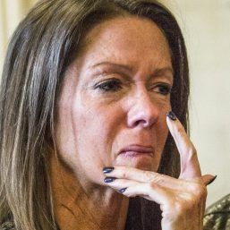 Susan Johnson wipes a tear from her cheek as James Pak receives two life sentences in the 2012 murders of her son, Derrick Thompson, and his girlfriend, Alivia Welch, on Superior Court in Alfred on Feb. 11, 2016. Johnson, who was wounded in the attack, is suing the city of Biddeford, claiming police didn't do enough to prevent the shooting.