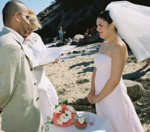 A couple marries at Acadia National Park, sharing the setting with several beachgoers (background).