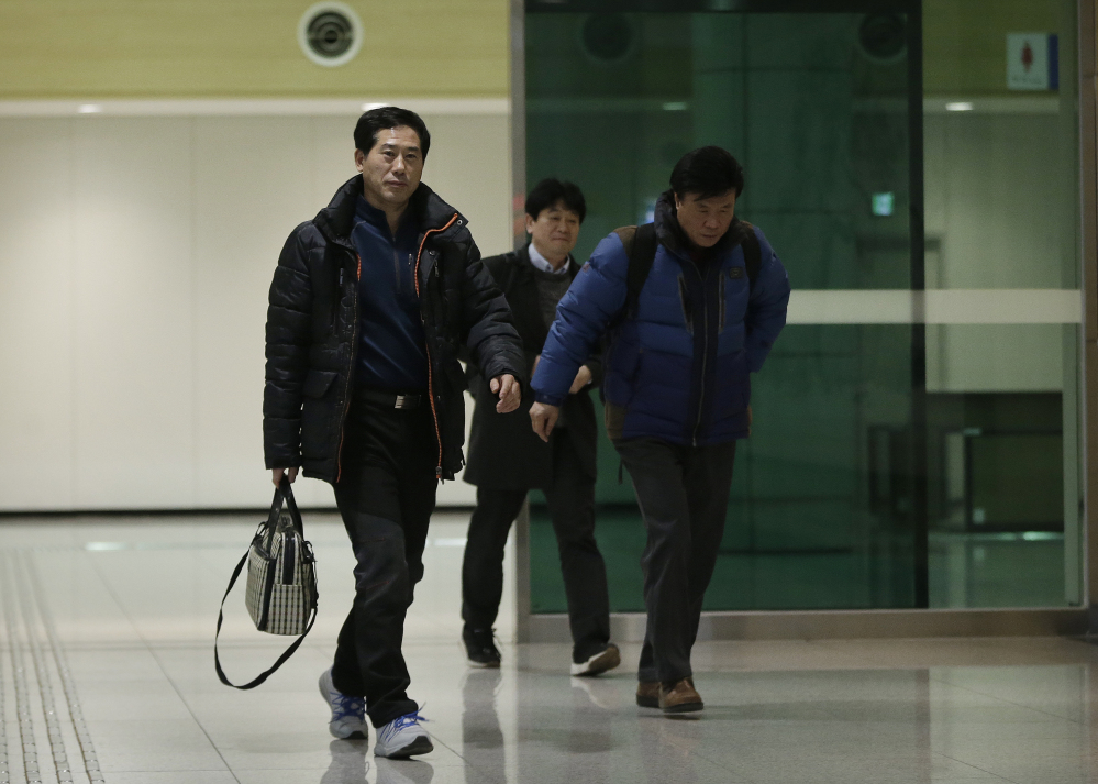 """The Associated Press South Korean businessmen return from North Korea's Kaesong Industrial Complex at the customs, immigration and quarantine office near the border village of Panmunjom, in Paju, South Korea, on Thursday. North Korea on Thursday ordered a military takeover of a factory park that had been the last major symbol of cooperation with South Korea, calling Seoul's earlier suspension of operations at the jointly run facility as punishment for the North's recent rocket launch a """"dangerous declaration of war."""""""