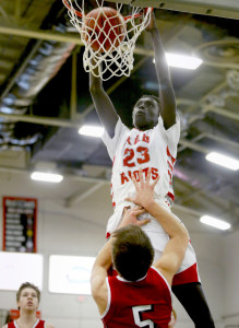 Ruay Bol of South Portland dunks over Sanford's Ethan Belanger during their Class AA South quarterfinal Thursday at the Portland Expo. South Portland, the No. 4 seed, rolled to a 62-44 win.