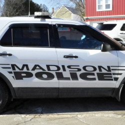 "Two Madison Police Department cruisers stand parked at the police station last March. The department was dissolved and the town contracted with the Somerset County Sheriff's Office in July. Former police Sgt. David Trask is suing for wrongful termination after the sheriff told him in December that his employment ""was not going to work out."""