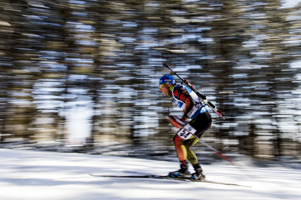 Erik Lesser of Germany pushes his way up a hill Thursday at Presque Isle as he competes in the 10-kilometer sprint at the BMW IBU World Cup Biathlon, in which competitors ski with .22-caliber rifles strapped to their backs.