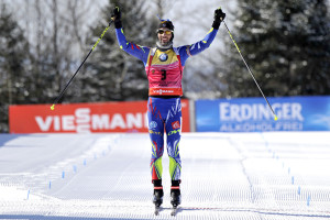 Martin Fourcade of France crosses the finish line as the winner of the men's 12.5-kilometer pursuit Friday at the IBU World Cup Biathlon in Presque Isle.