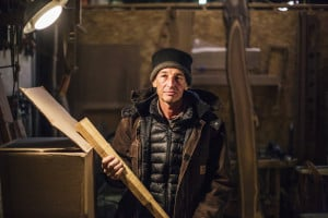 David Moses Bridges, a maker of traditional Passamaquoddy birch bark canoes, is working in a South Portland workshop on a model of one of his vessels while he undergoes cancer therapy at Maine Medical Center in Portland.
