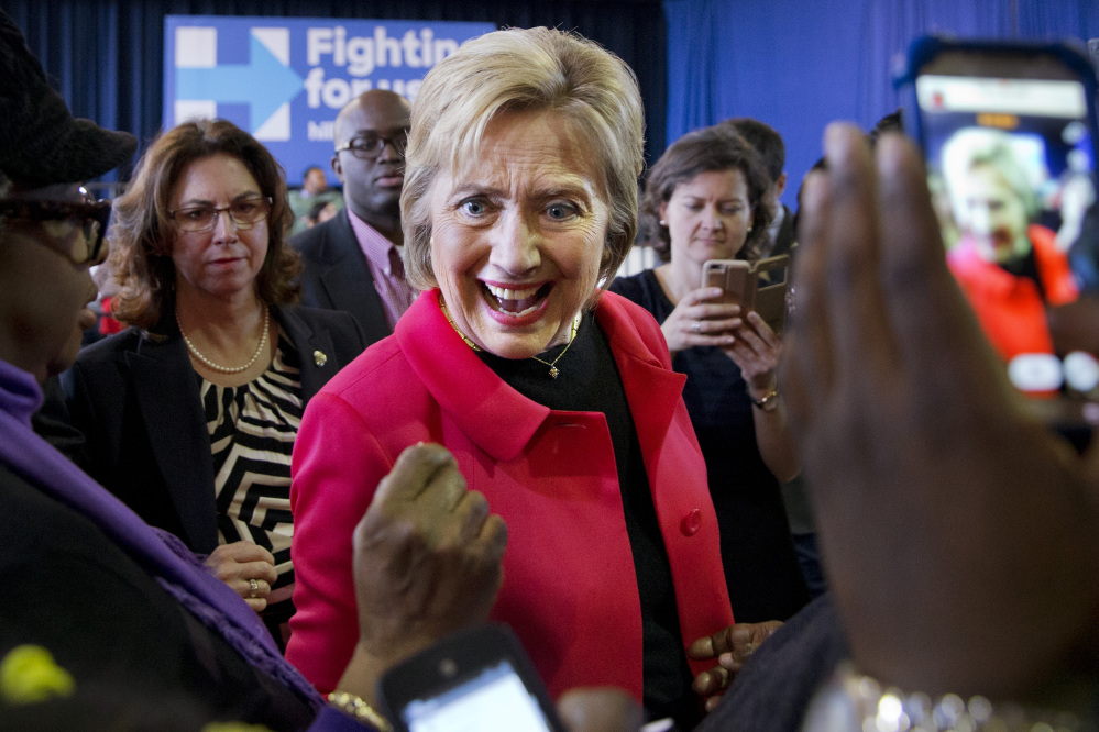 Democratic presidential candidate Hillary Clinton reacts to a greeting from a child after speaking during a town hall meeting in Denmark, S.C., Friday.