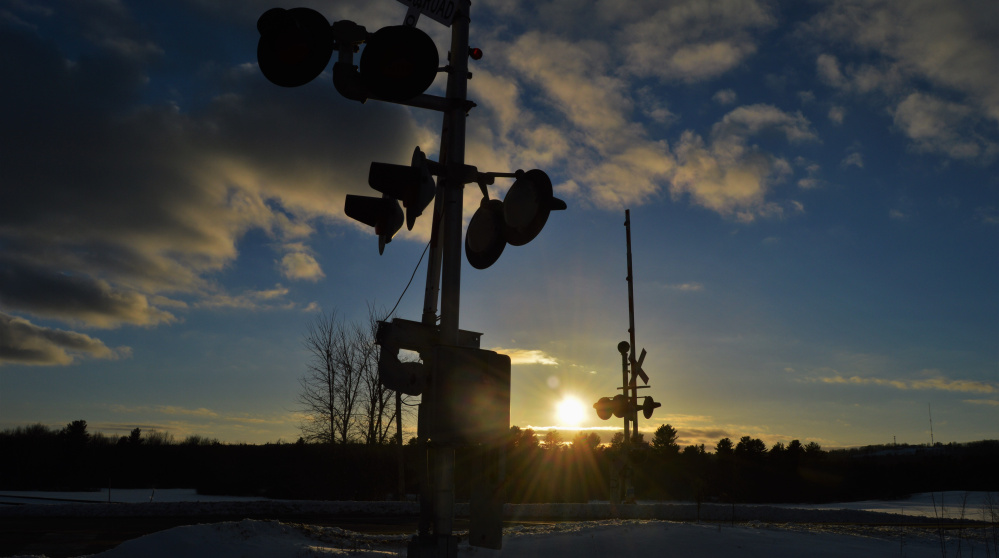 The steel rails turn cold as the sun sets at the crossing on Route 231 in New Gloucester, where Brian Lovering of North Yarmouth was about to cross.