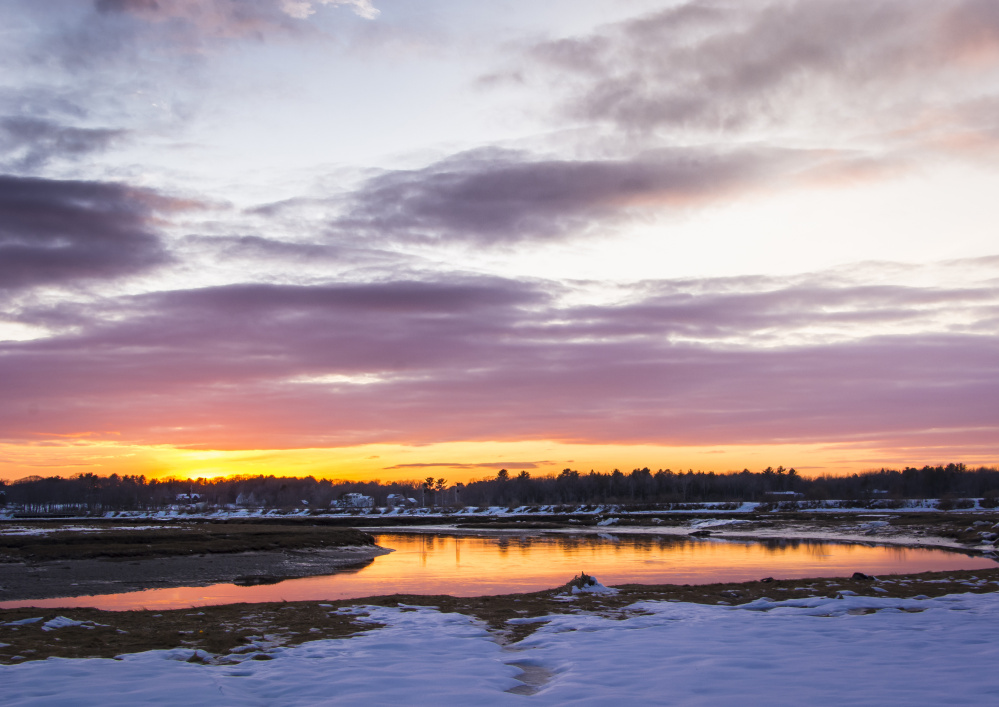 A long, thin sunset leaves shadows and vivid colors over the Scarborough Marsh as a mild winter's day succumbs to dusk, with resident Ann Blanchard there to capture the impressive imagery.