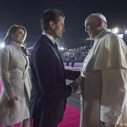 In this photo taken on Friday, Feb. 12, 2016, Pope Francis is welcomed by Mexico's President Enrique Pena Nieto and first lady Angelica Rivera upon his arrival to the Benito Juarez International Airport in Mexico City.
