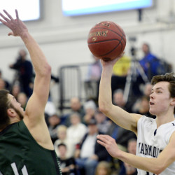 Yarmouth's Bailey Darling shoots over Spruce Mountain's Andrew Darling during a Class B South boys' semifinal Saturday at the Portland Expo. (Photo by Shawn Patrick Ouellette/Staff Photographer)