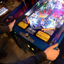 Marc Patenaude of Portland plays a game of pinball during the IFPA Maine State Pinball Championship on Saturday.