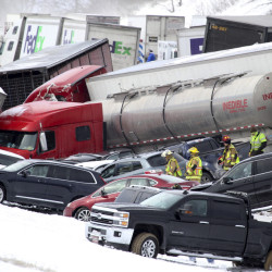 Emergency personnel work at the scene of a crash near Fredericksburg, Pa., on Saturday. State police say a pileup has closed Interstate 78 in central Pennsylvania.
