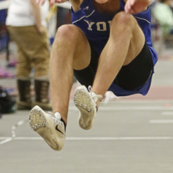 Matt Arsenault of York jumps 40 feet, 3  inches to win the triple jump Saturday during the Class B indoor track state championships at Bates College. Arsenault also placed third in the 55-meter hurdles, helping the Wildcats claim the team championship for the fourth time in five years.