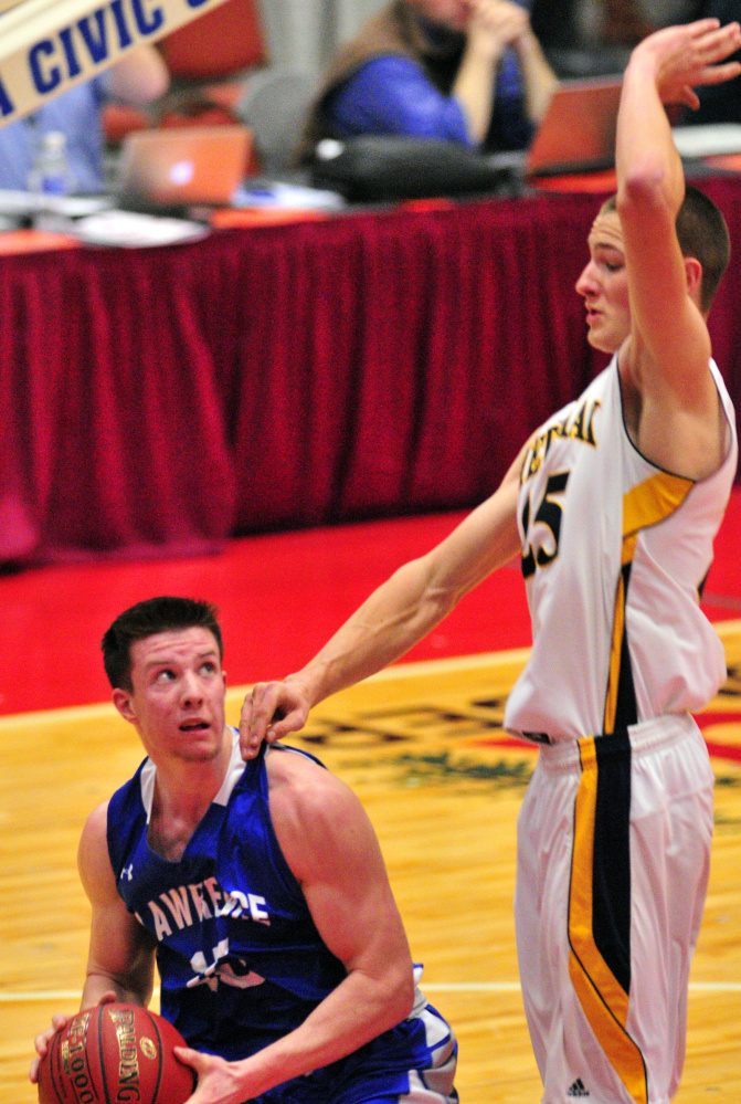 Seth Powers of Lawrence looks for room to shoot Saturday while being guarded by Cameron Allaire of Medomak Valley during Medomak's 62-44 victory.