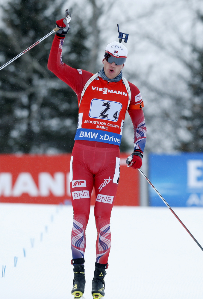 Norway's Tarjei Boe crosses the finish line after leading his team to victory on Saturday. The Norwegians beat France by 30.1 seconds, while Germany finished third.