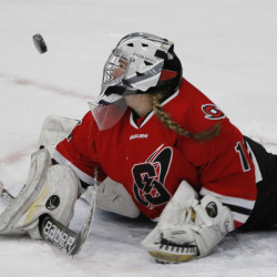 Goalie McKenzie Cormier of Scarborough deflects a puck during the girls' hockey state championship game Saturday at the Androscoggin Bank Colisée in Lewiston. (Photo by Joel Page/Staff Photographer)