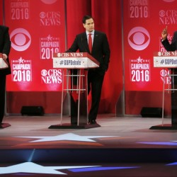 Retired neurosurgeon Ben Carson, right, speaks as Donald Trump and Sen. Marco Rubio, R-Fla., look on during the CBS News Republican presidential debate at the Peace Center on Saturday in Greenville, S.C.