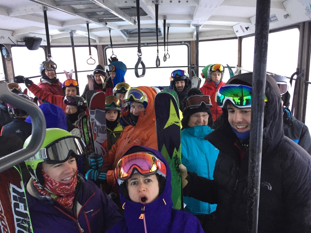 People stand in a tram car Sunday, Feb. 14, 2016, after it became stuck 40 feet off the ground in sub-zero temperatures at Cannon Mountain Aerial Tramway in Franconia, N.H. Crews have rescued 48 people from two tram cars at the New Hampshire ski resort after it became stuck. A Cannon Mountain spokesman says officials said there was a service brake issue. Crews do not believe the cold temperature was a factor. No injuries have been reported.