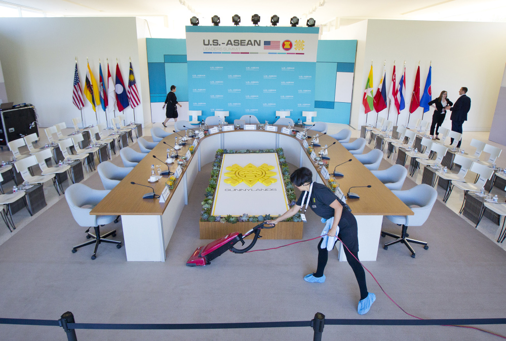 Maria Mendoza cleans and vacuums around the head table as last minute preparation are made at the Annenberg Retreat at Sunnylands in Rancho Mirage, Calif., site of today's meeting of ASEAN, the 10-nation Association of Southeast Asian Nations,  Monday, Feb. 15, 2016. President Barack Obama is hosting the ASEAN leaders, it is the first meeting of its kind on U.S. soil, as he looks to deepen ties with the region's fast-growing economies.