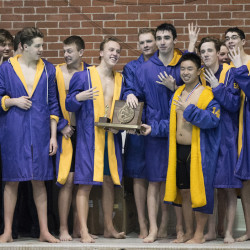 Members of the Cheverus boys' swim team celebrate with the championship trophy Monday after winning the Class A state title – for the fourth year in a row – at the University of Maine in Orono. Kevin Bennett photo