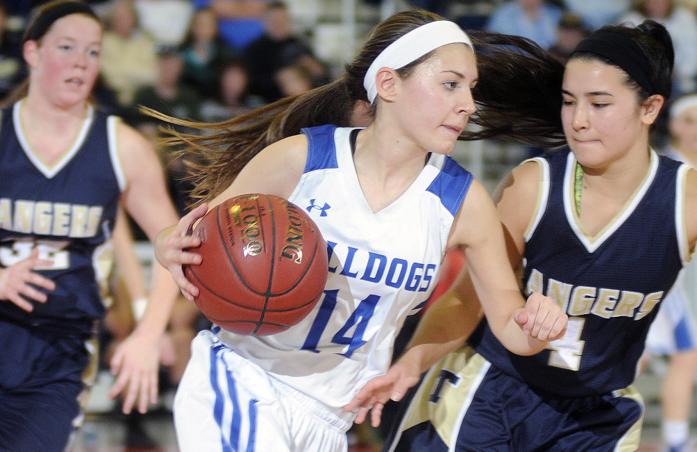 Madison's Sydney LeBlanc drives against Kiara Perez, right, of Traip Academy during a Class C South quarterfinal Tuesday at the Augusta Civic Center. LeBlanc scored 10 points in Madison's 43-30 win.