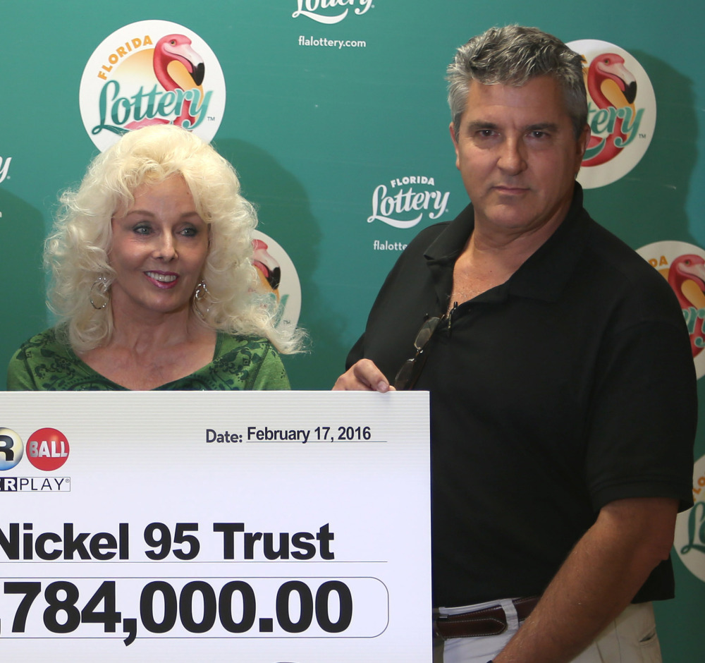 Maureen Smith and David Kaltschmidt with their one-third share of the Jan. 13, world record Powerball jackpot Wednesday, Feb. 17, 2016, in Tallahassee, Fla. John and Lisa Robertson of Munford, Tenn., cashed in their ticket last month, also taking the lump sum. The winners in California have not publicly come forward yet. (AP Photo/Steve Cannon)