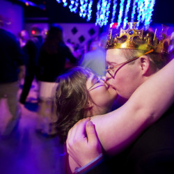 Marie Christie and Caleb Dunlap, a couple with Down syndrome, kiss on the dance floor at the Night to Shine prom at Eastpoint Christian Church in Portland. Sponsored by the Tim Tebow Foundation, dance parties held across the country attracted thousands of participants.