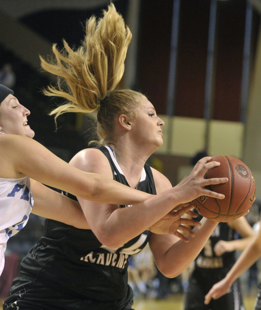 Samantha Burke of Lincoln Academy pulls down a rebound during a Class B South semifinal Thursday against Mountain Valley. Lincoln upended the top-seeded Falcons, 34-32.