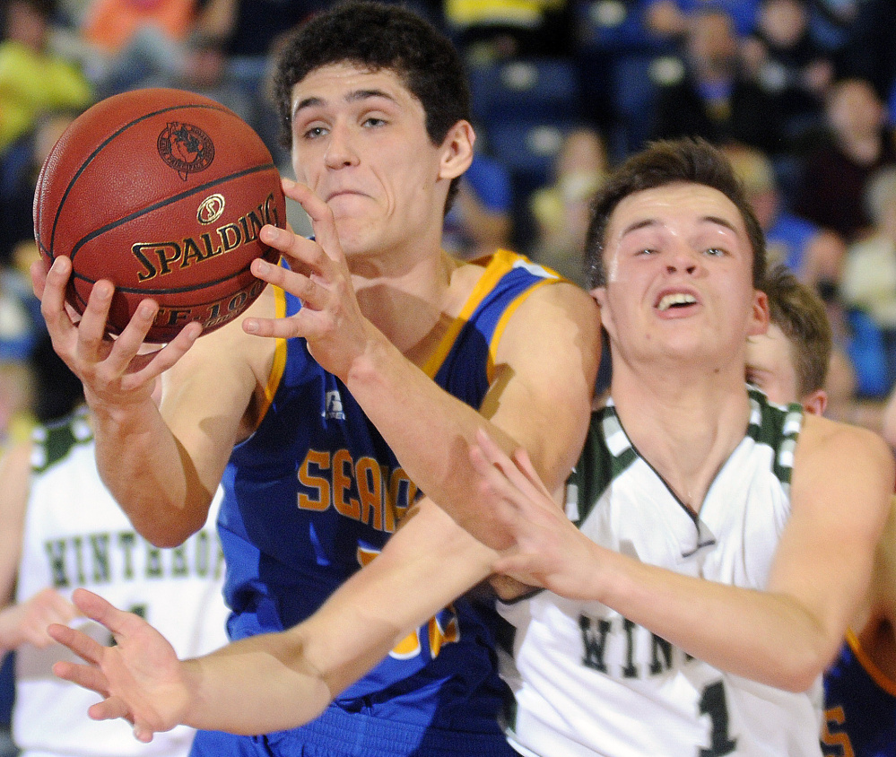Boothbay's Abel Bryer, left, collides with Bennett Brooks of Winthrop during a Class C South boys' basketball semifinal Thursday night in Augusta. Winthrop won, 45-31.