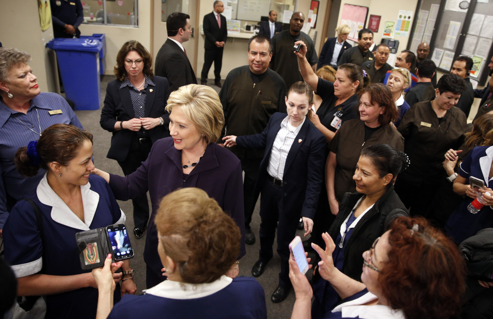 Democratic presidential candidate Hillary Clinton, second from left, meets with employees of Paris Las Vegas during a visit to the hotel and casino Thursday.