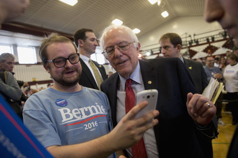 Democratic presidential candidate Sen. Bernie Sanders, I-Vt., pauses for a photo with a supporter at a rally Friday in Elko, Nevada.