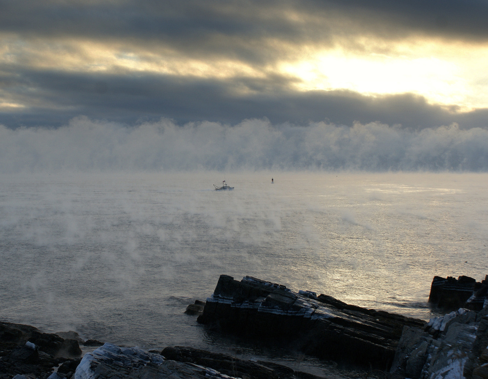 Looking like the ghosts of mariners who never made it back to port, sea smoke rises from outside Portland Harbor on one of last week's frigid mornings that found Jewel Church of South Portland observing the untamed beauty at Portland Head Light.