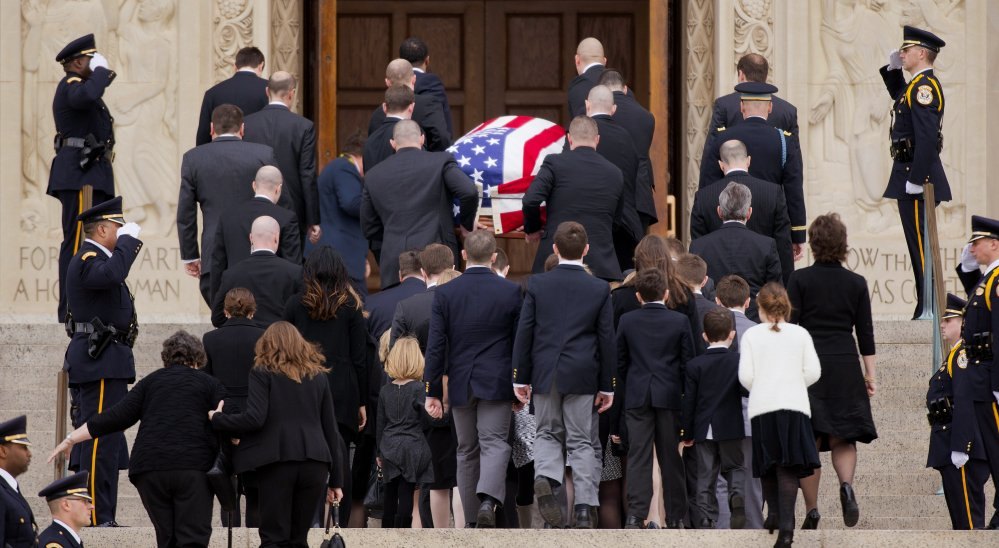 Family members follow behind the casket of the late Supreme Court Associate Justice Antonin Scalia as they arrive for a funeral mass at the Basilica of the National Shrine of the Immaculate Conception in Washington, Saturday.