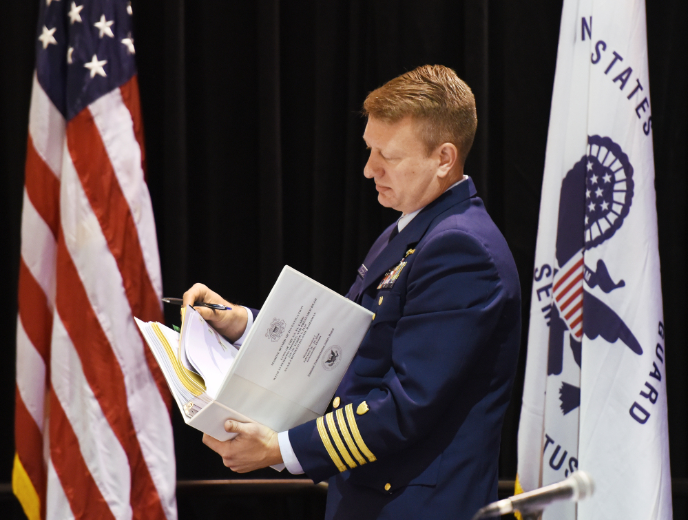 Coast Guard Capt. Jason Neubauer, the chairman of the El Faro hearing board, looks over his hearing notebook.