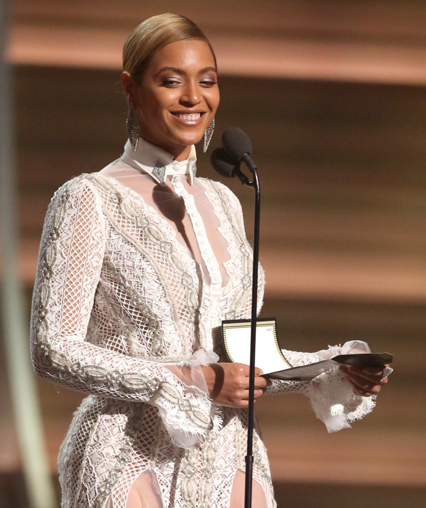 Beyonce presents the award for record of the year at the 58th annual Grammy Awards on Monday, Feb. 15,