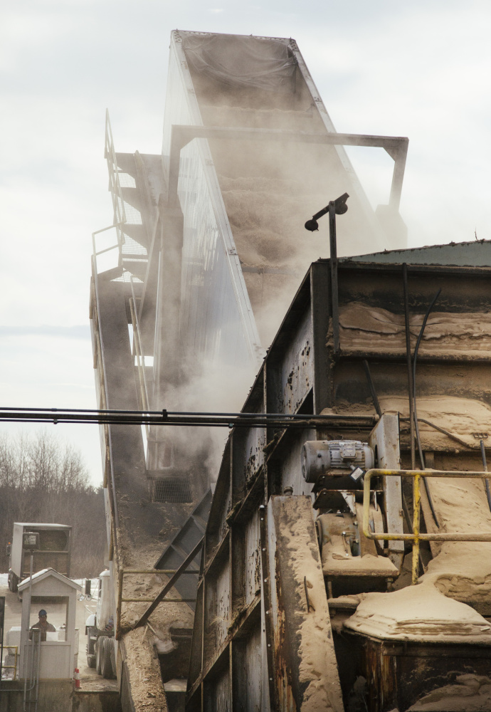 A semi filled with wood biomass fuel is tipped and unloaded at ReEnergy biomass plant in Livermore Falls. (Whitney Hayward/Staff Photographer)