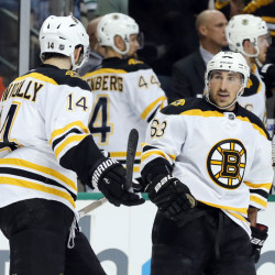 Boston Bruins' Brett Connolly (14) congratulates Brad Marchand (63) on his goal against the Dallas Stars in the first period of an NHL hockey game, Saturday, Feb. 20, 2016, in Dallas. (AP Photo/Tony Gutierrez)