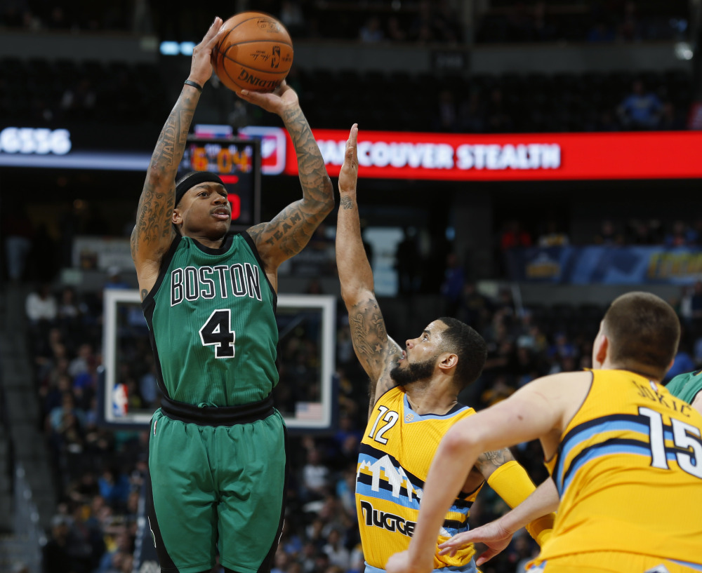 Celtics guard Isaiah Thomas scored 22 points in Boston's 121-10 victory over the Nuggets on Sunday in Denver. (The Associated Press)
