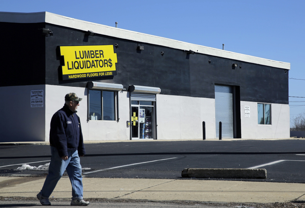 A man walks past a Lumber Liquidators store in Philadelphia. The company stopped selling laminate floors made in China last May after reports they held high levels of formaldehyde.
