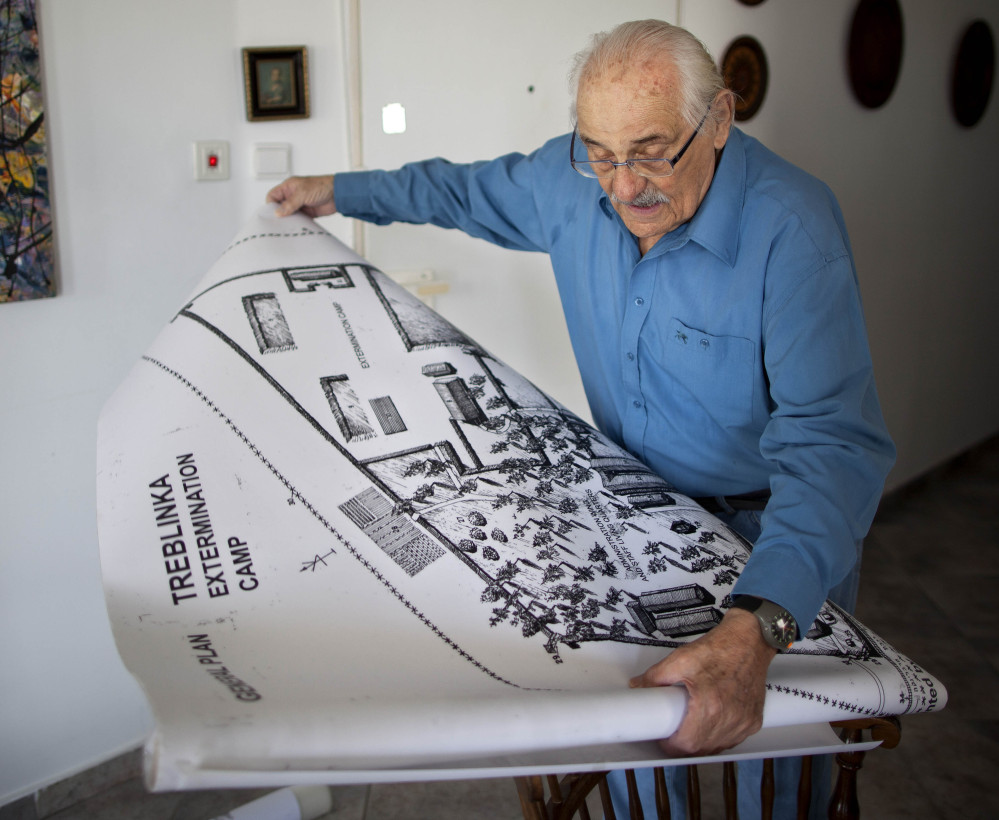 Holocaust survivor Samuel Willenberg displays a Treblinka camp map during a 2010 interview. As more survivors die, historians and educators try to prepare for a world with no personal witnesses to the genocide, often through collected testimonies.
