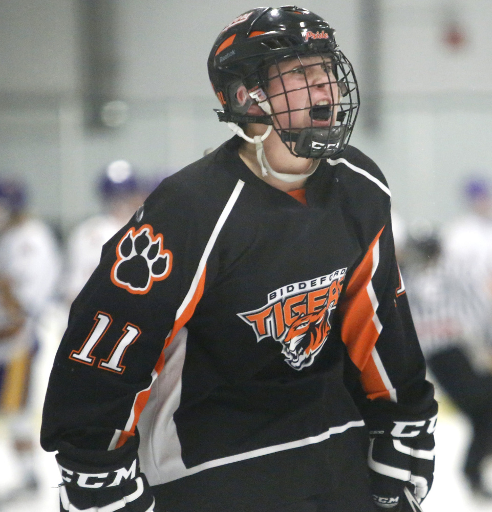 Logan Magnant lets out a roar after Biddeford took the lead in the third period of its Class A South quarterfinal against Cheverus on Monday. The Tigers lost 6-5 in overtime.