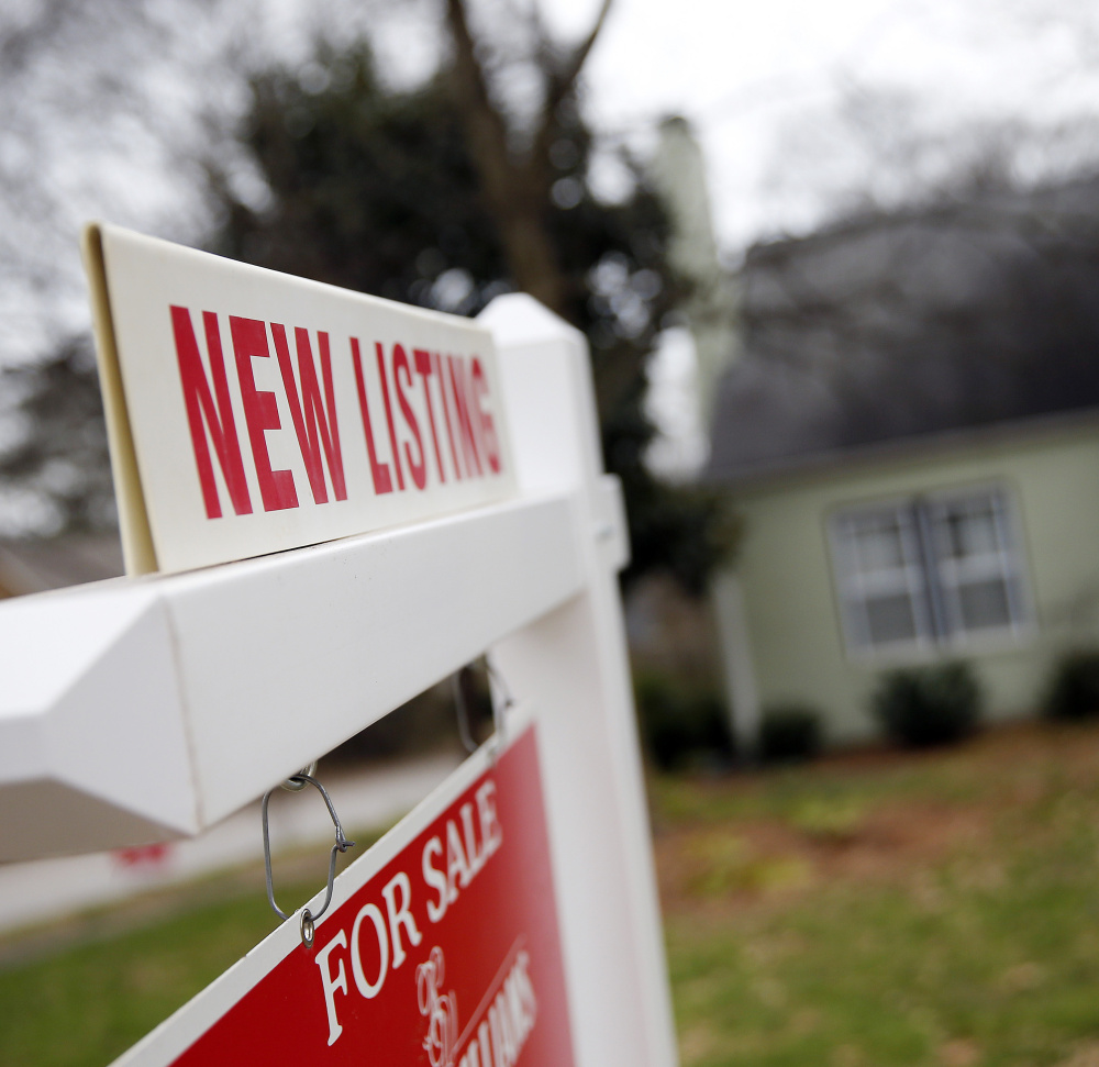 """Because many homes have become unaffordable for would-be buyers, """"for sale"""" signs might remain in yards for a long time.    The Associated Press"""