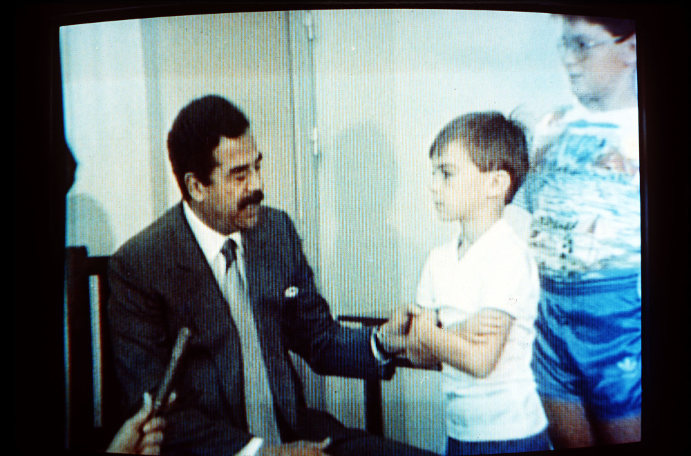 FILE -- In this undated 1990 file photo, Iraqi President Saddam Hussein, speaks with Western British hostages in an image made from Iraqi TV. Twenty five years after the first U.S. Marines swept across the border into Kuwait in the 1991 Gulf War, American forces find themselves battling the extremist Islamic State group, born out of al-Qaida, in the splintered territories of Iraq and Syria. The Arab allies that joined the 1991 coalition are fighting their own conflicts both at home and abroad, as Iran vies for greater regional power following a nuclear deal with world powers. (AP Photo, File)